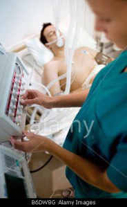 intensive-care-patient-nurse-adjusting-controls-on-a-ventilator-attached-b6dw8g (1)